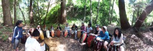 Girls play percussion with Marcie in the redwood groves of Garapata Creek
